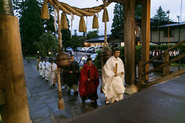 Head priest leads participants into the shrine.